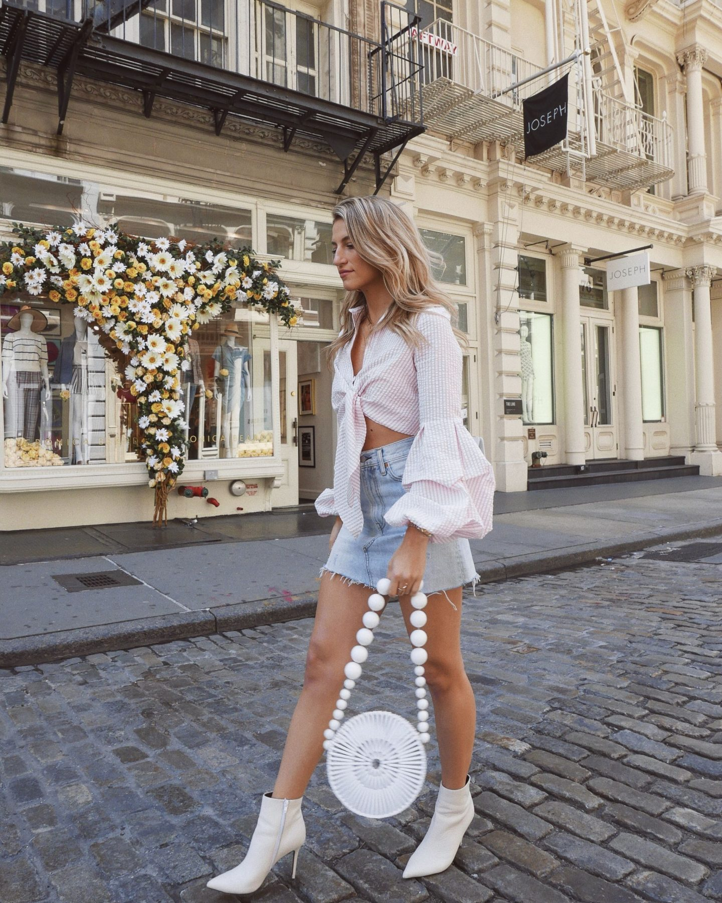 Cassandra DiMicco, Cass DiMicco, Dressed For Dreams, NYC, New York City, New York, Street Style NYC, Street Style 2018, NYC Street Style Street Style Outfits, 2018 Trends, NYC Fashion Blogger, soho, white booties, cult Gaia, cult Gaia bag, petersyn top, striped tie front top, ruffle sleeves, Levis, denim skirt, Levis denim skirt