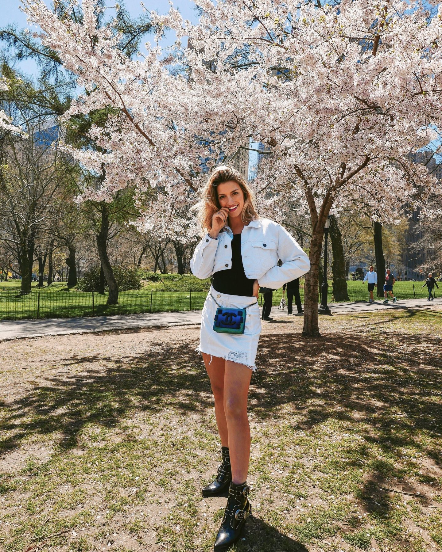 Cassandra DiMicco, Cass DiMicco, Dressed For Dreams, NYC, New York City, New York, Street Style NYC, Street Style 2018, NYC Street Style Street Style Outfits, 2018 Trends, NYC Fashion Blogger, Central Park, Western Boots, Western Booties, White Denim Jacket, White Denim Skirt, Chanel Crossbody Bag, NYC Instagram Spots