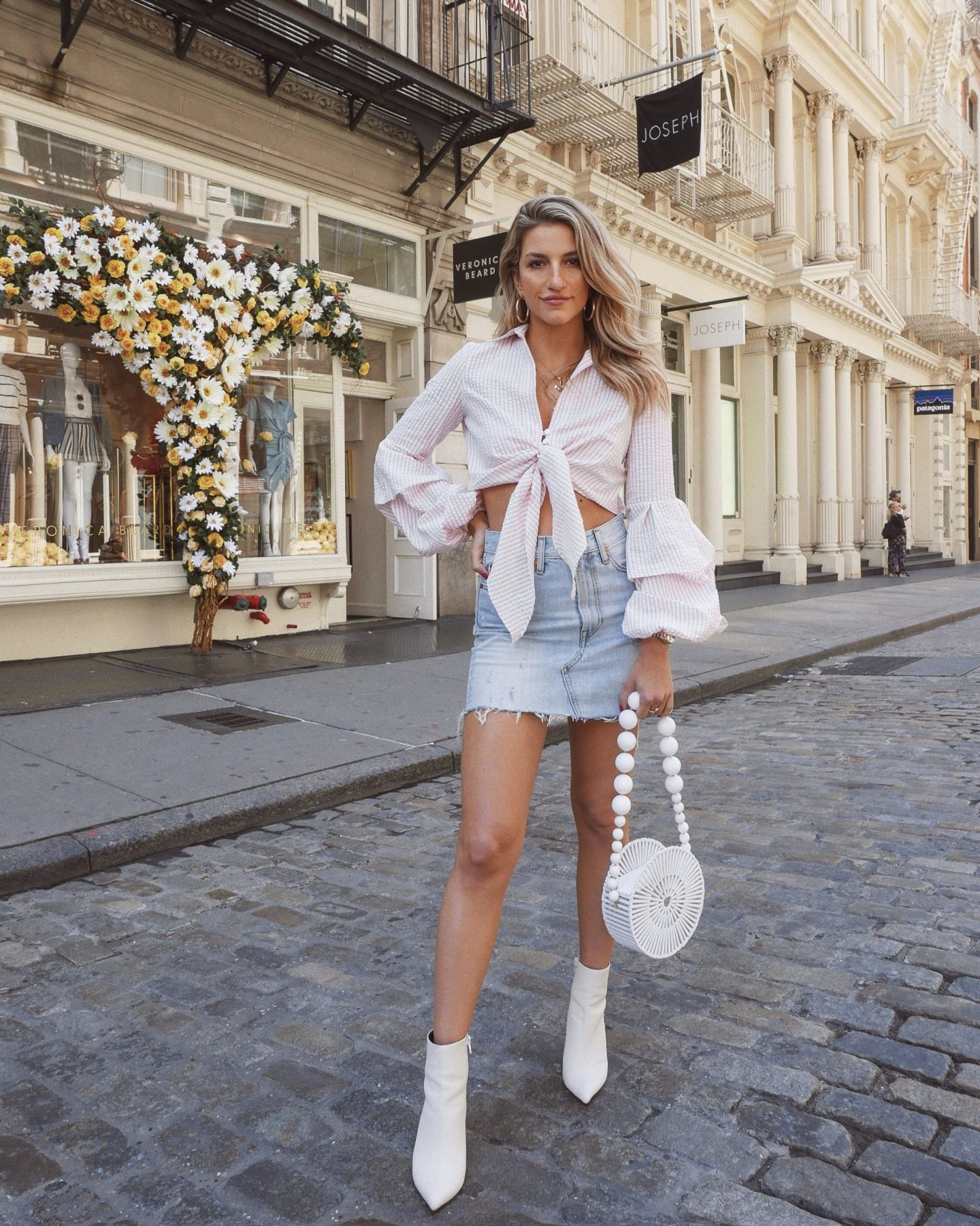 Cassandra DiMicco, Cass DiMicco, Dressed For Dreams, NYC, New York City, New York, Street Style NYC, Street Style 2018, NYC Street Style Street Style Outfits, 2018 Trends, NYC Fashion Blogger, soho, petersyn top, striped tie front top, cult Gaia bag, cult Gaia, white booties, Levis, denim skirt, Levis denim skirt