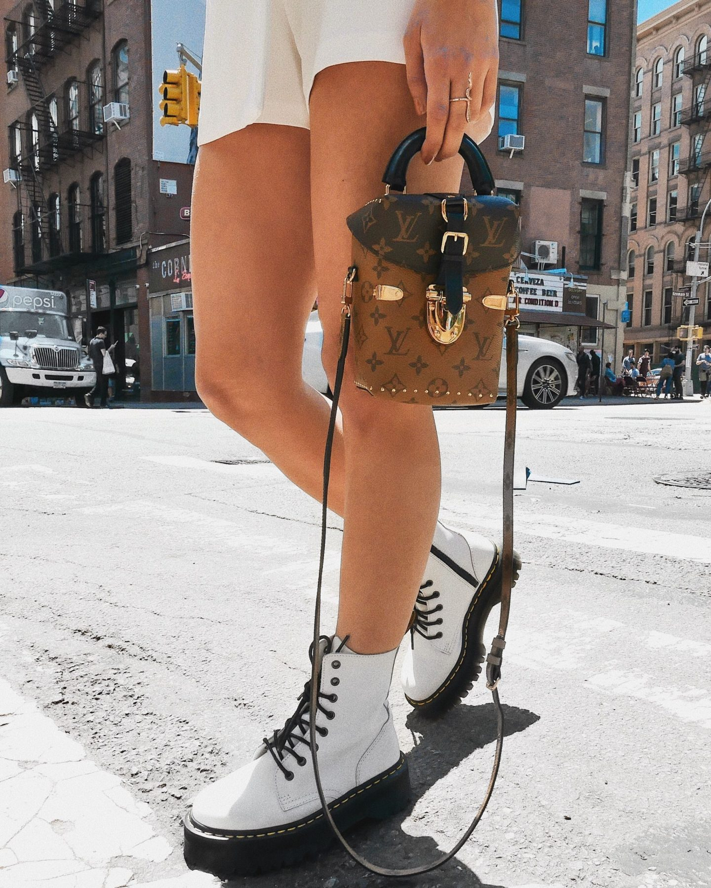Cassandra DiMicco, Cass DiMicco, Dressed For Dreams, NYC, New York City, New York, Street Style NYC, Street Style 2018, NYC Street Style Street Style Outfits, 2018 Trends, NYC Fashion Blogger, NYC to do list, NYC to do, NYC bucket list, NYC Instagram Spots, SoHo, Dr. Martens Boots, Platform Dr. Martens, Doc Martens, White Platform Boots, White Dr. Martens, White Platform Dr. Martens, Louis Vuitton Reverse Monochrome Camera Box Bag, Louis Vuitton Camera Box Bag, Louis Vuitton Bag, River island, River island romper, White Tux romper, white romper