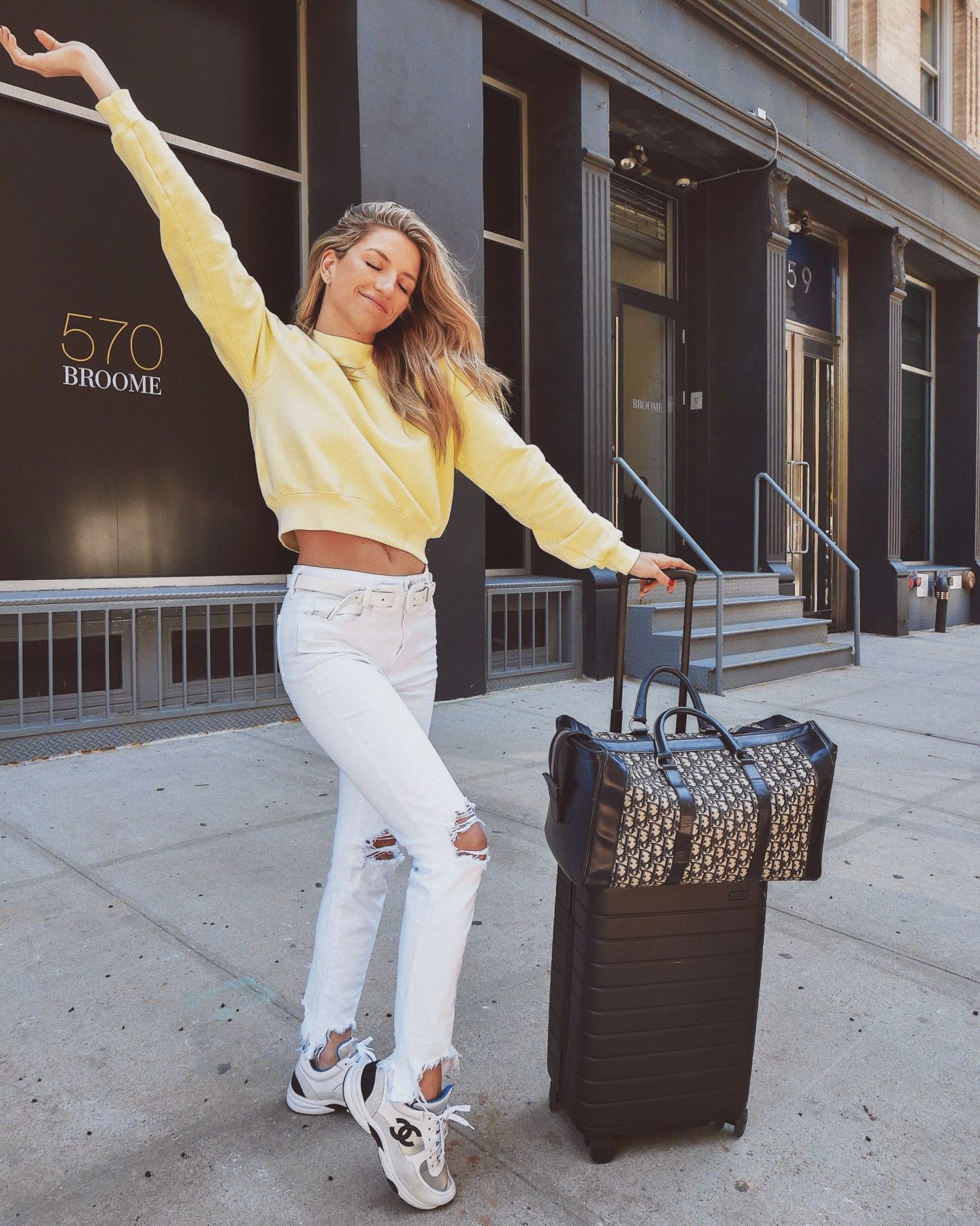 Cassandra DiMicco, Cass DiMicco, Dressed For Dreams, NYC, New York City, New York, Street Style NYC, Street Style 2018, NYC Street Style Street Style Outfits, 2018 Trends, NYC Fashion Blogger, intermix, intermix yellow sweatshirt, yellow cropped sweatshirt, l'agence jeans, white l'agence jeans, Chanel sneakers, dad sneakers, 2018 trend, Dior duffle bag, away luggage