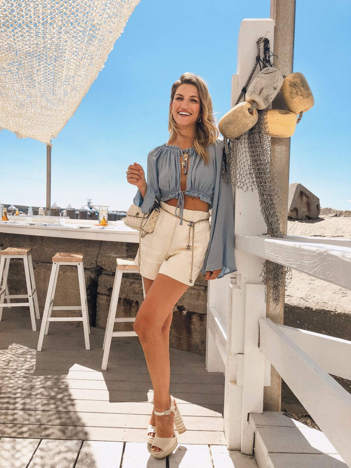 Cassandra DiMicco, Cass DiMicco, Dressed For Dreams, NYC, New York City, New York, Street Style NYC, Street Style 2018, NYC Street Style Street Style Outfits, 2018 Trends, NYC Fashion Blogger, NYC to do list, NYC to do, NYC bucket list, NYC Instagram Spots, Duryea's Lobster Deck, Duryea's Montauk, Montauk, The Hamptons, Hamptons Eats, Blue Life Tropicana Tie Top, Blue Life Crop Top, Blue Life Tropicana Top, Helmut Lang Shorts, Helmut Lang, Schutz Jane Platforms, Schutz Heels, Chanel Belt, Chanel Chain Belt, Vintage Chanel, Valentino Rockstud Purse, Summer Outfit Inspo, 2018 Trends