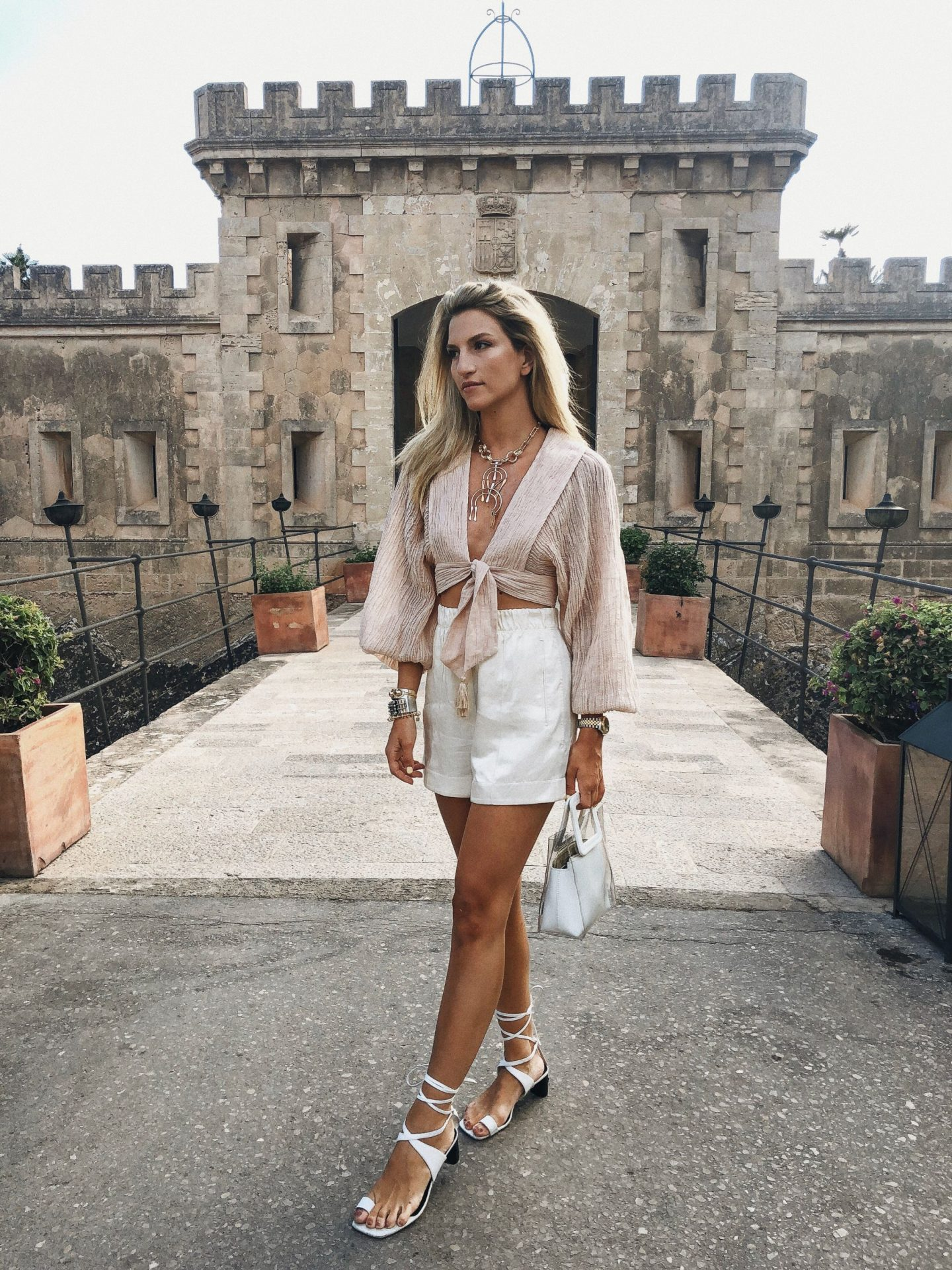 Cassandra DiMicco, Cass DiMicco, Dressed For Dreams, NYC, New York City, New York, Street Style NYC, Street Style 2018, NYC Street Style Street Style Outfits, 2018 Trends, Summer Style, Summer Outfit Inspo, Europe Outfit Inspo, NYC Fashion Blogger, Celine Wrap Sandals, Celine, Helmut Lang, Helmut Lang Shorts, Helmut Lang Ivory Silk Shorts, Zimmermann, Zimmermann Tie Front Top, Staud Clothing, Staud PVC Bag, Staud Shirley Leather PVC, Mallorca, Mallorca Inspo, Mallorca Outfit Inspo, Mallorca Vacation