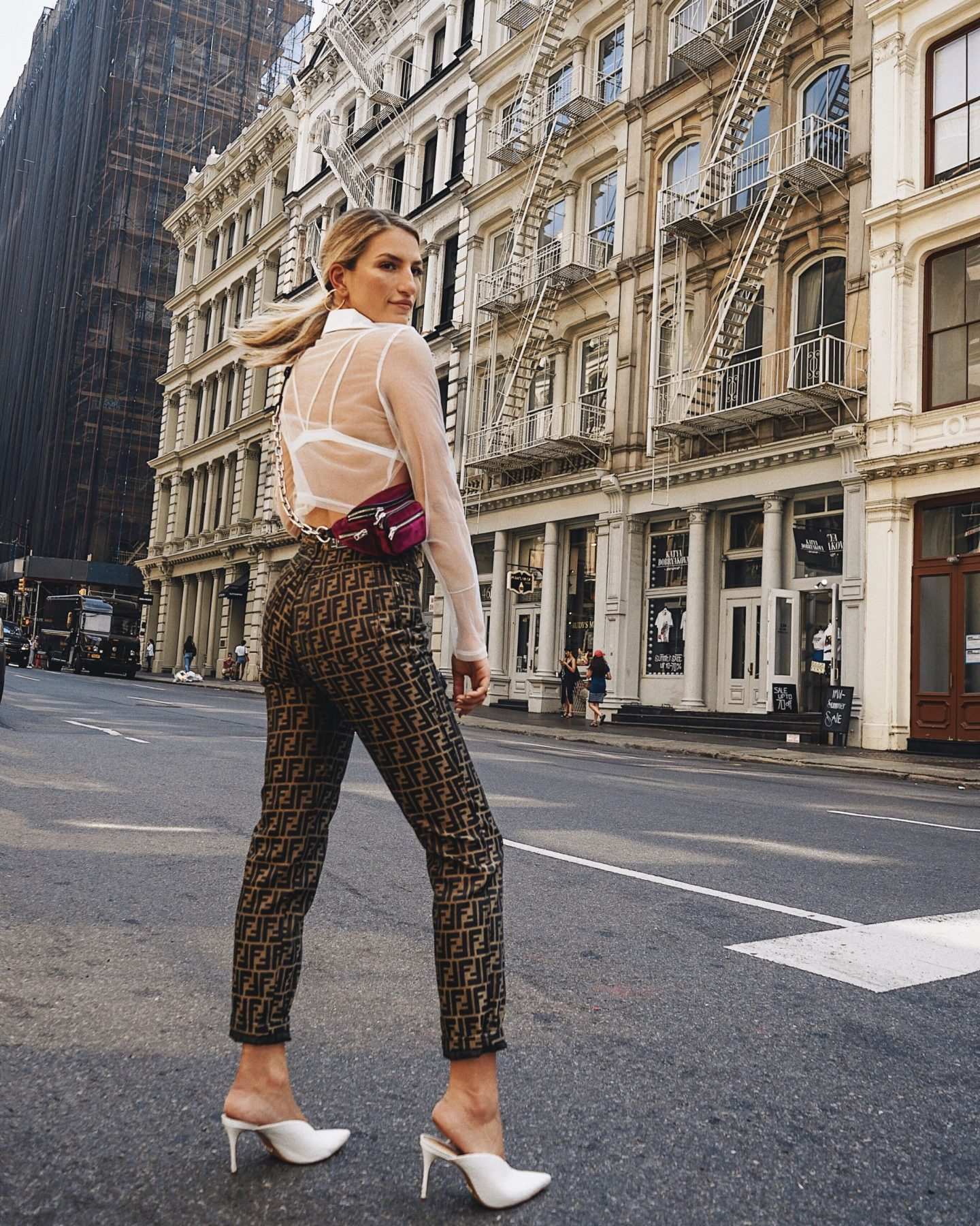 Cassandra DiMicco, Cass DiMicco, Dressed For Dreams, NYC, New York City, New York, Street Style NYC, Street Style 2018, NYC Street Style, NYC Outfit Inspo Street Style Outfits, 2018 Trends, Summer Style, Summer Outfit Inspo, NYC Fashion Blogger, NYC Fashion Blogger, NYC to do list, NYC to do, NYC bucket list, NYC Instagram Spots, vintage fendi pants, sheer crop top, vintage fendi, fendi logo pants, fendi, Alexander wang, Alexander wang Attica fanny pack, Schutz Charla mules, white heeled mules, heeled mules, schutz mules