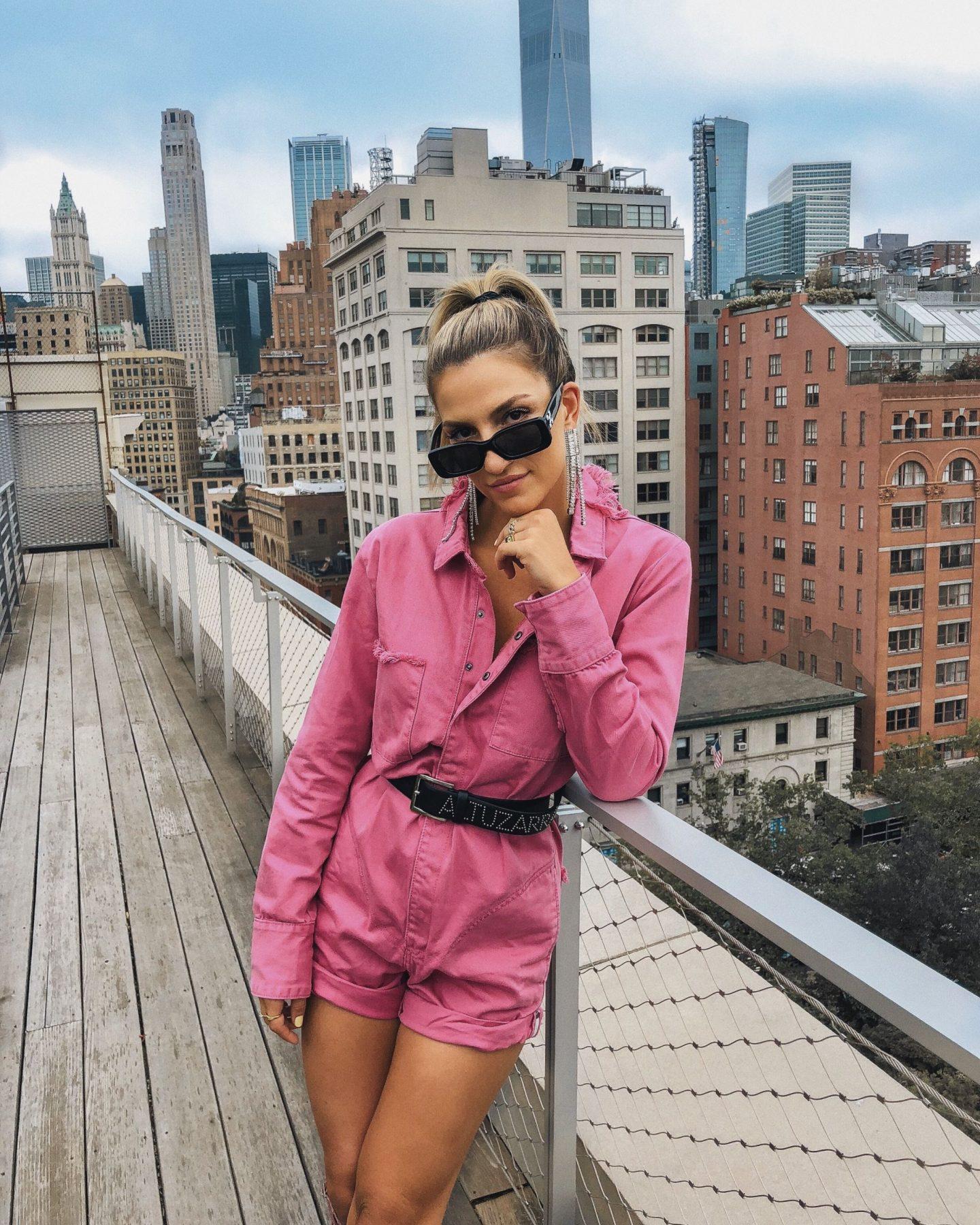 Cassandra DiMicco, Cass DiMicco, Dressed For Dreams, NYC, New York City, New York, Street Style NYC, Street Style 2018, NYC Street Style, NYC Outfit Inspo Street Style Outfits, 2018 Trends, Summer Style, Summer Outfit Inspo, NYC Fashion Blogger, NYC Fashion Blogger, NYC to do list, NYC to do, NYC bucket list, NYC Instagram Spots, NYFW Outfit, NYFW Inspo, One Teaspoon pink jumpsuit, one teaspoon, off white sunglasses, off white, altuzarra belt, altuzarra, altuzarra gladiator heels, altuzarra pink snakeskin, Alexander wang belt bag, Alexander wang fanny pack, Alexander wang