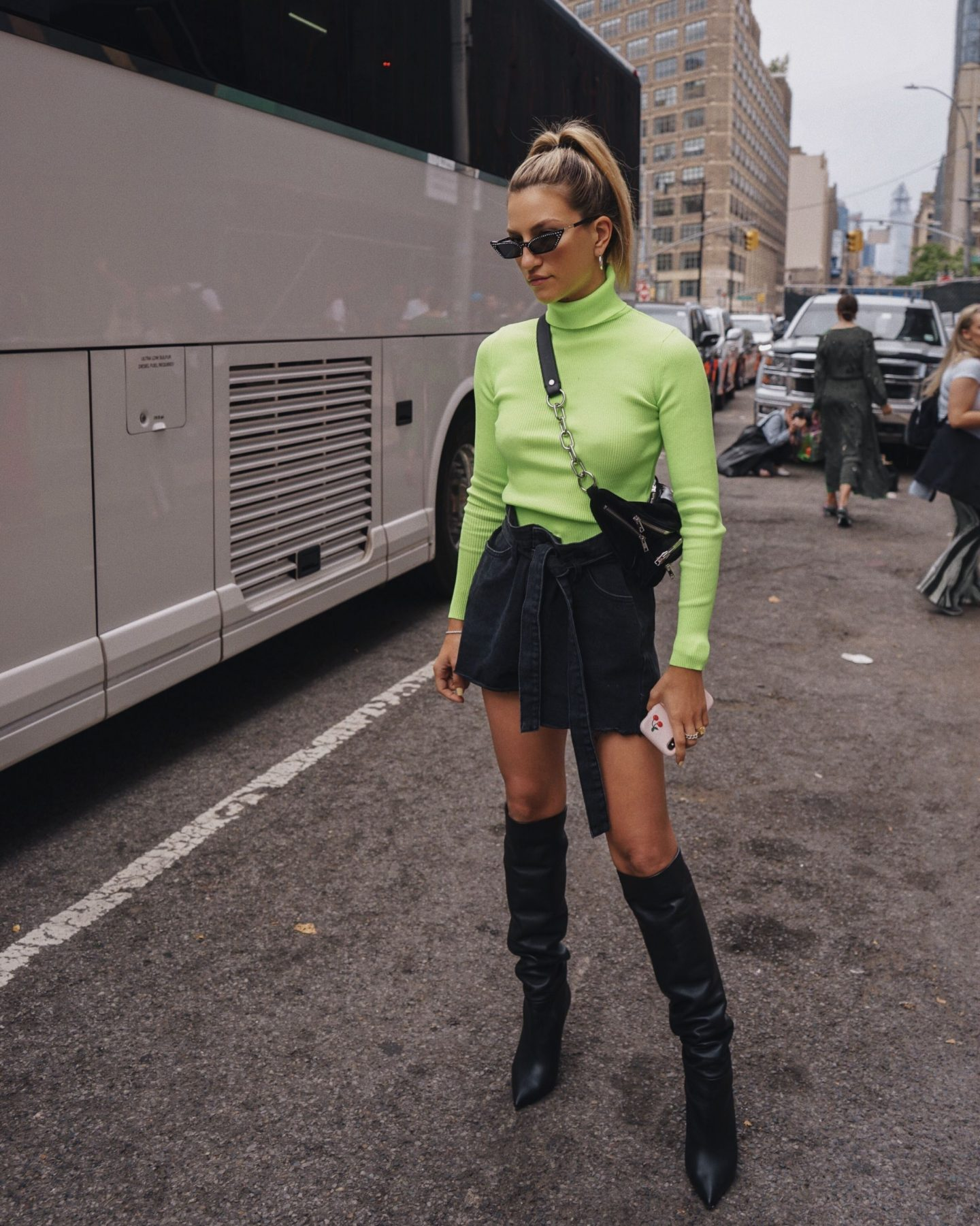 Cassandra DiMicco, Cass DiMicco, Dressed For Dreams, NYC, New York City, New York, Street Style NYC, Street Style 2018, NYC Street Style, NYC Outfit Inspo Street Style Outfits, 2018 Trends, Summer Style, Summer Outfit Inspo, NYC Fashion Blogger, NYC Fashion Blogger, NYC to do list, NYC to do, NYC bucket list, NYC Instagram Spots, neon turtle neck sweater, storets Edith belted denim skirt, tamara Mellon boots, Alexander wang fanny pack, poppy lissiman sunnies, nyfw, nyfw outfit, nyfw street style