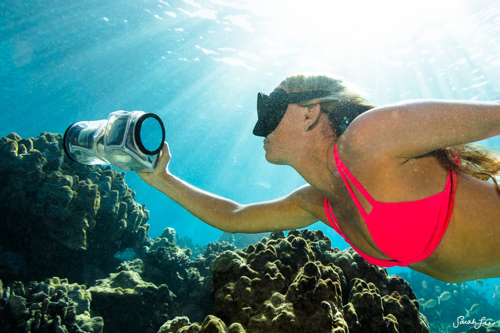Adventure filmmaker Alison Teal, photographing the reef in Hawaii with the new clear Outex Underwater Housing for DSLR and Mirrorless cameras.