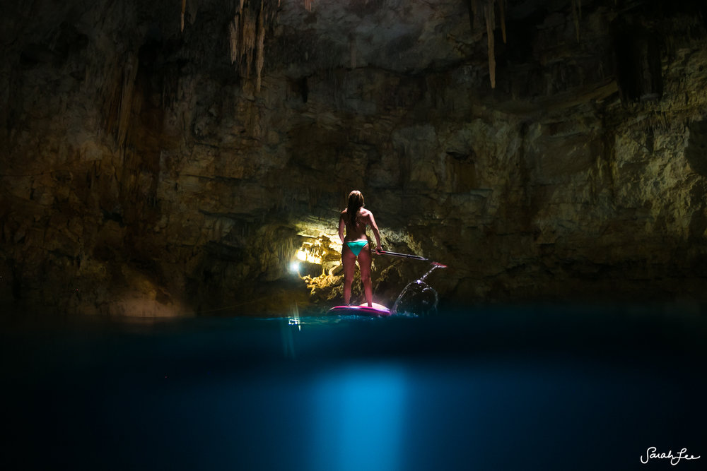 Split-level shot of adventurer Alison Teal in a cenote in Mexico. Taken with the Outex dome port and Canon 16-35mm wide angle lens.
