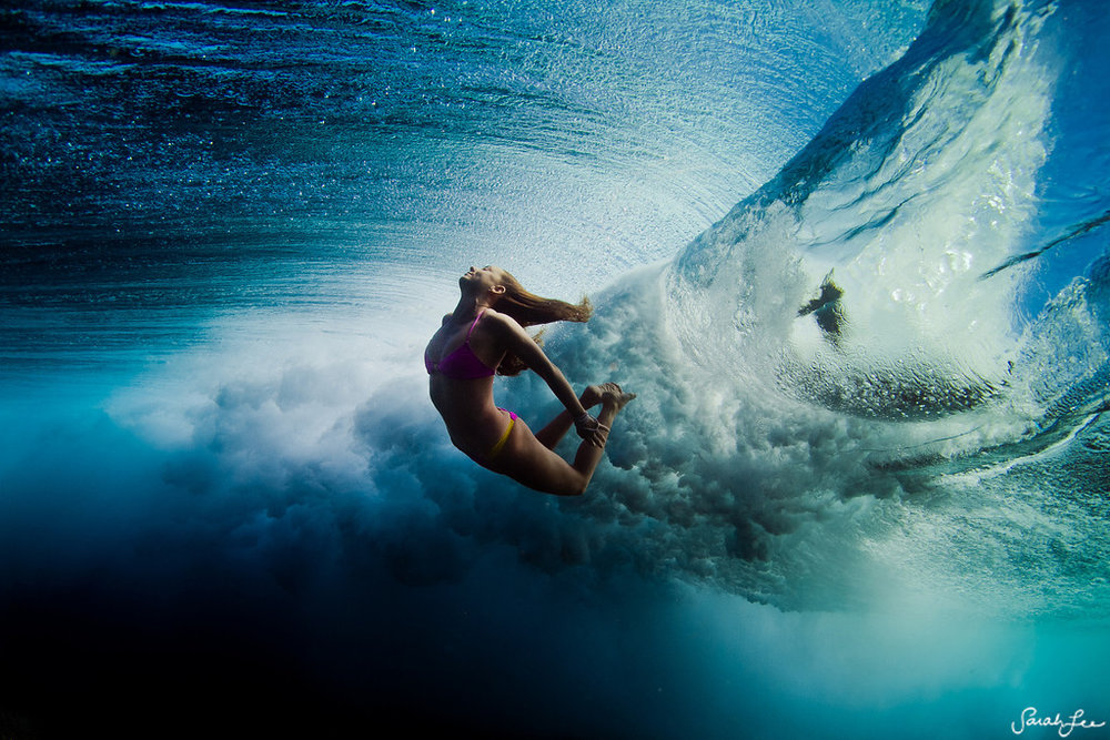 This photograph was taken of adventure model and soul surfer, Alison Teal, somewhere in the warm waters of Fiji.