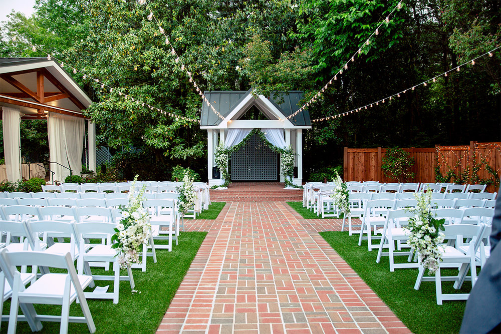 Flint Hill - Enchanting Colonial Estate in Lawrenceville, GA.Little Gardens is a colonial style special event venue burrowed in the midst of a 3-acre estate in Lawrenceville, Georgia. This beautiful estate offers an enchanted outdoor ceremony area, as well as a beautifully designed ballroom.