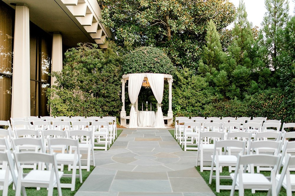 Lush Gardens - Variety of ceremony space optionsGarden in bloom year-roundGazebo and three-tiered fountain