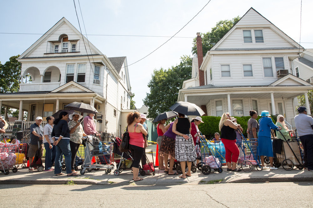 Every day in New York City, thousands of people stand in line for hours, waiting for a bag of groceries at local food pantries. Originally conceived as an emergency ration, with staples for three meals for three days, a pantry visit is the new normal for families whose incomes can no longer keep pace with the cost of living.