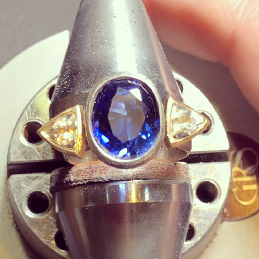 Custom sapphire ring created with my client's sapphires — the blue one was gifted to her by her father before he passed when she was just a little girl.