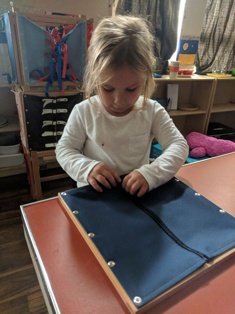 zipper work at montessori.jpg