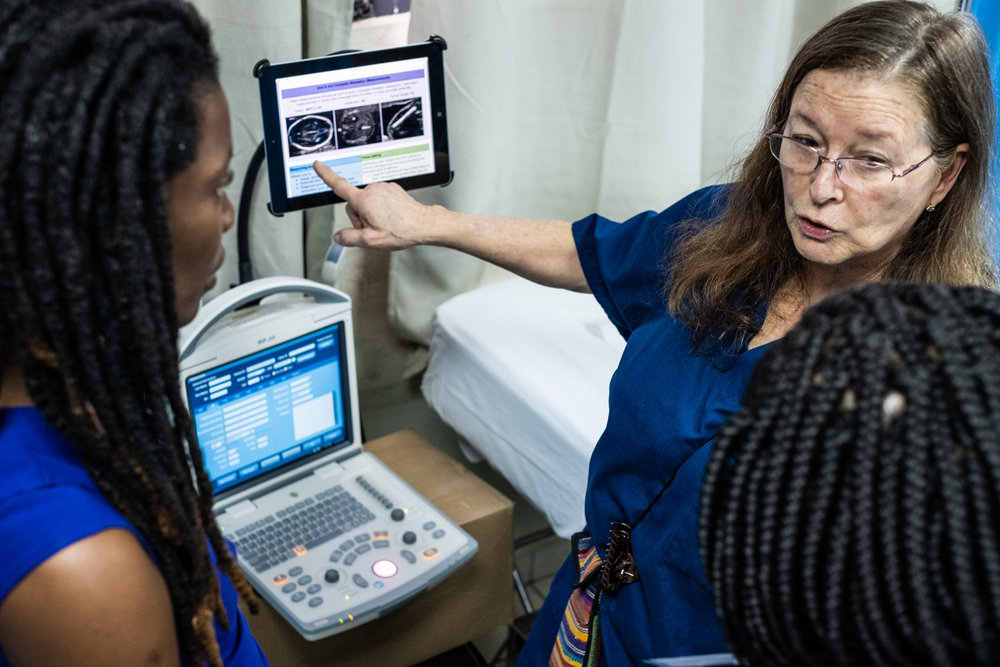 During the hands-on NYAGI training week, International OB/GYN and expert sonographer, Alicia Martin-Hirsel, shows how to use the NAV™ software in preparation for scanning the next patient.