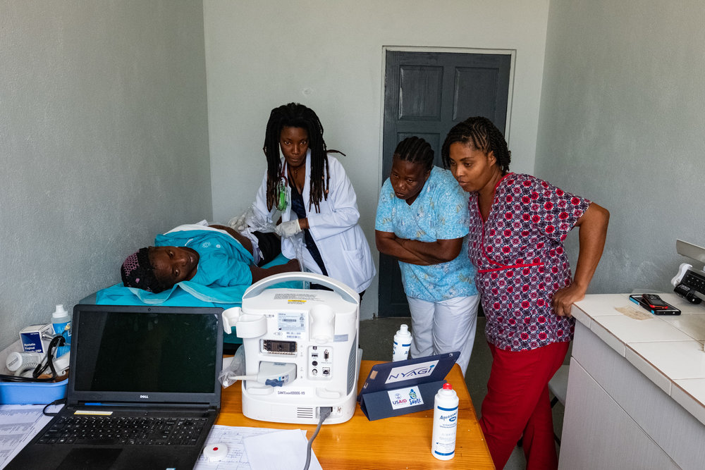 After returning to her rural clinic in Haiti, Dr. Darline Molin Dol, Medical Director of the Project Medishare Centre de Santé/Maternite de Lahoye shares her newly acquired ultrasound knowledge with her nurses, showing them how to use the NAV™ software as a resource for independent-learning.