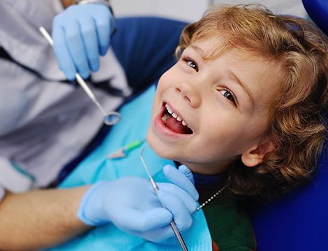 kid-smiling-dentist.jpg