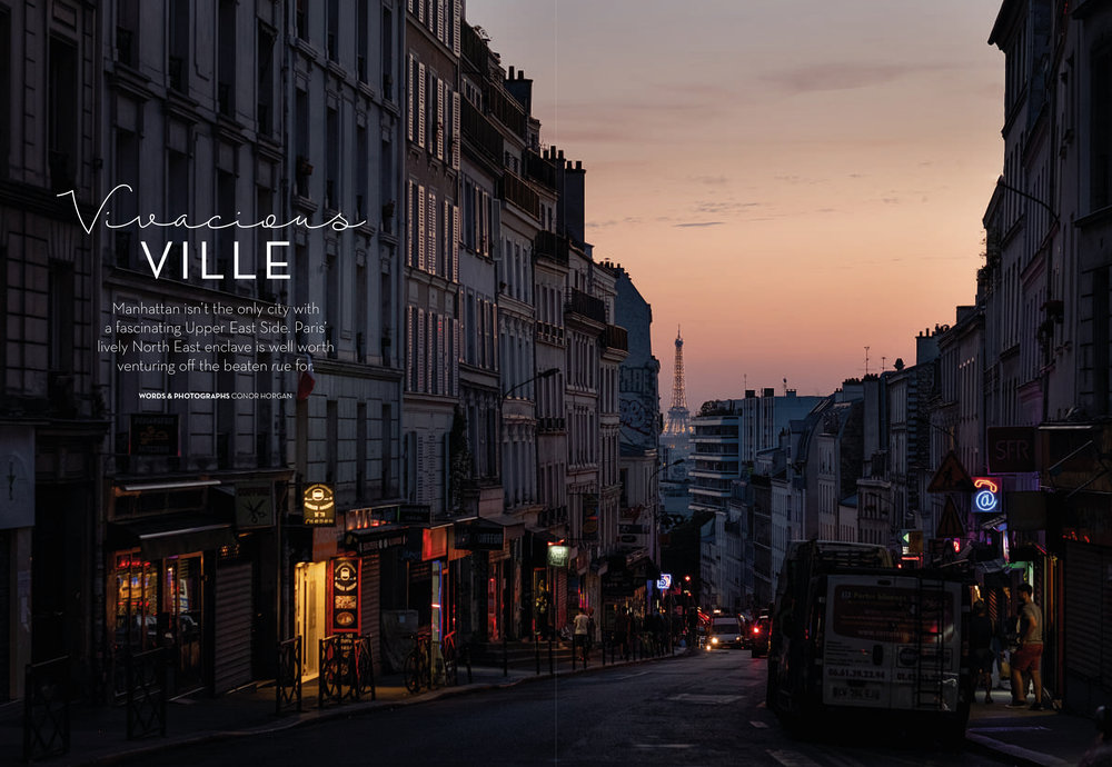 The sun sets on Rue de Belleville and the Eiffel Tower.