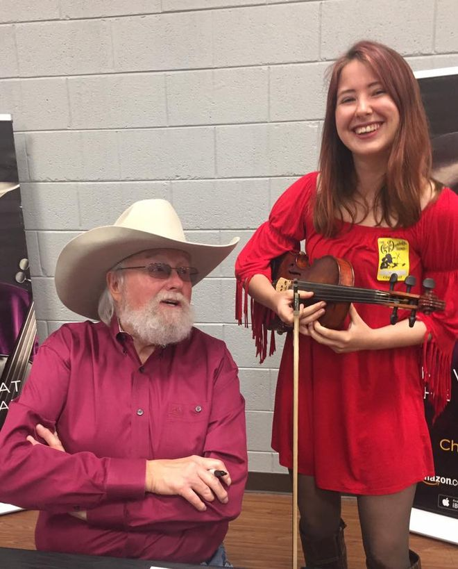 Meeting and playing for Charlie Daniels backstage in Savannah, Ga who complimented my fiddle style.