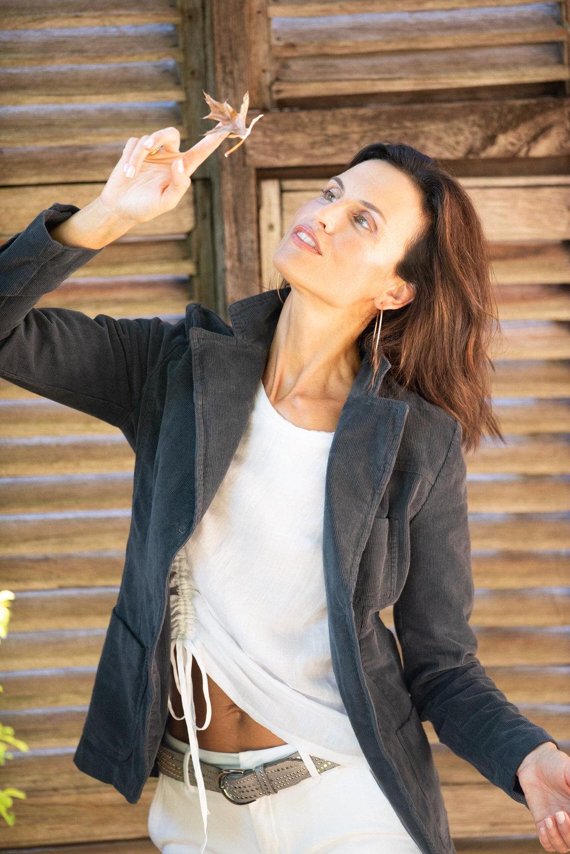 [All available @ Enzo & Toto] Abigail wears European Culture Cord Jacket $435, Zoe Kratzmann Wink Top $189, Reiko Sandy Basic Chino White $189, b.belt Silver Studs Light Grey Belt $269 and Torini Hoop Earrings $95.