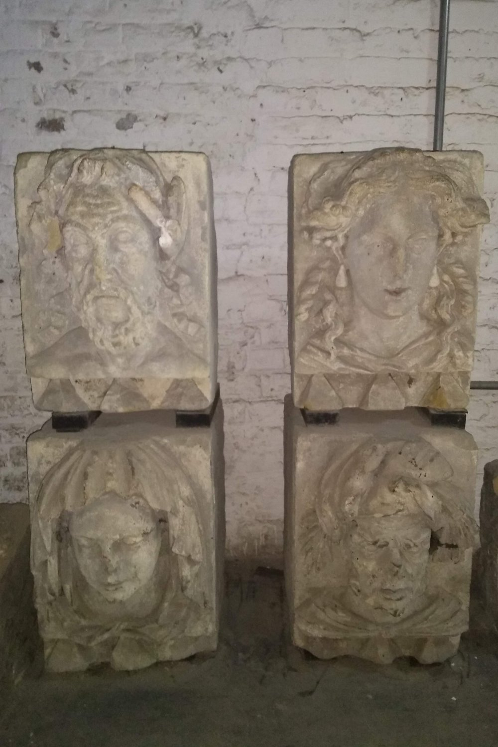 The stone-carved heads in the Undercroft to Queen Anne at the Old Royal Naval College, University of Greenwich