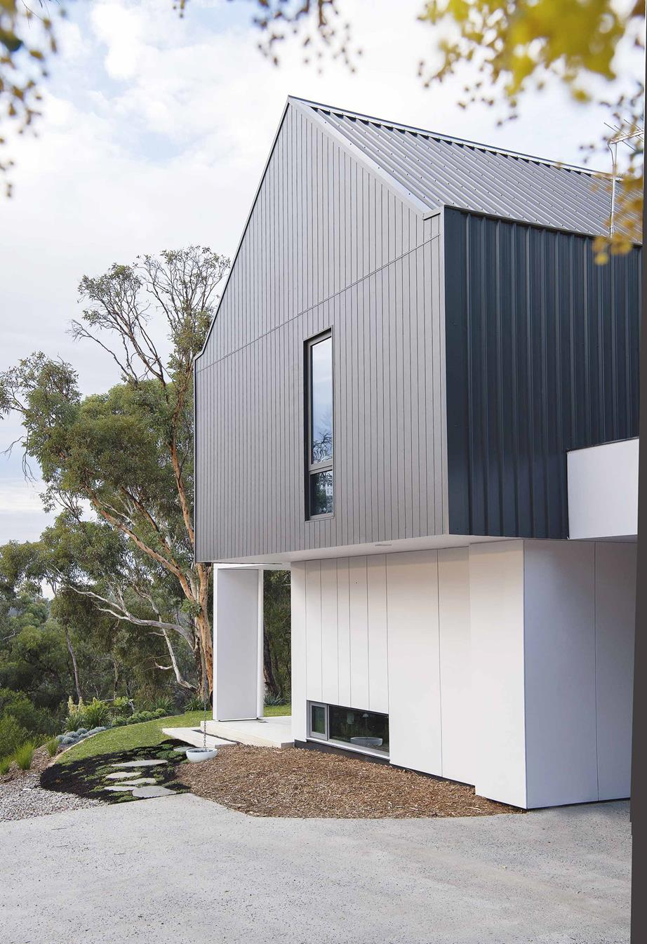 Exterior  The roof and first floor of Izabela and Lukasz Katafoni's Perth home are clad with  Colorbond  'Trimdek' in Monument, while the gable wall is clad in Scyon 'Axon' from  James Hardie  in the same colour. Scyon 'Matrix' cladding in  British Paints  Grey Spirit is used on the ground floor. The concrete paving was hand-poured by the couple.