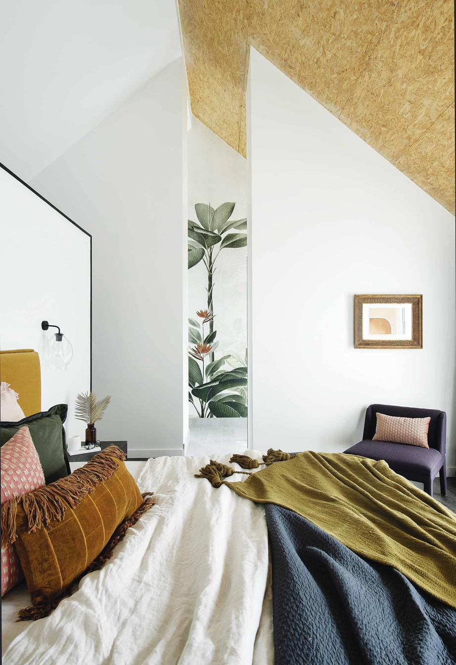 Master bedroom  Cushions from  Asbury Park Agency ,  Adairs ,  HK Living  and  Freedom , and Adairs bedlinen and throws, enliven the all-white palette. A Søktas sconce casts light at night and is mounted on the reverse of the walk-in robe behind the bed.
