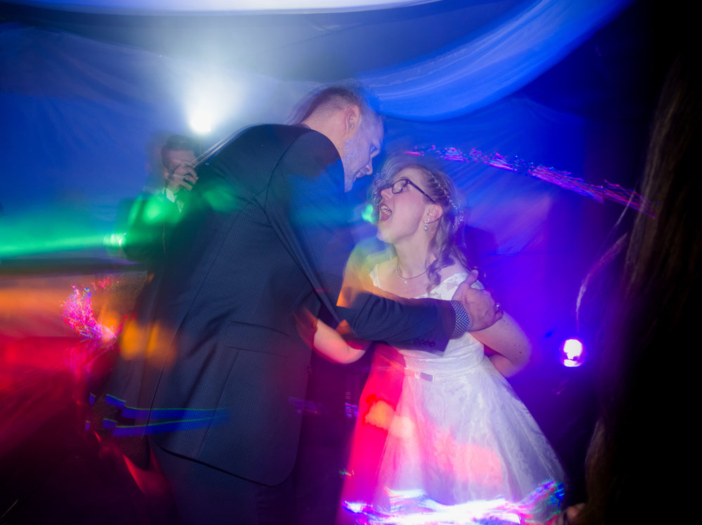 Bride and groom dancing at their wedding party. ISO 250, f/4.5, 1-second exposure