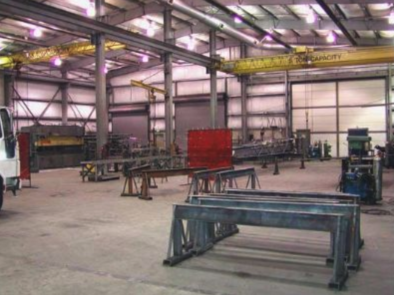 SHOP - A modern and well equipped 18,000 square foot shop building gives us the space and capability for welding, shearing, braking, rolling, cutting, CNC plasma cutting, punching and machining. Equipped with two full length overhead cranes, large fabrication bays, and spacious lay down areas, we can handle jobs, both large and small, efficiently.