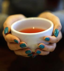 tea in hands 300x274