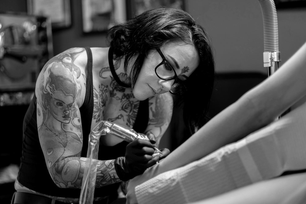 Jes Swisher- Tattoo Artist & Body Piercer - 8+ years experience as a tattoo artist and body piercer. Specializes in watercolor and fine line tattoos.Fun Fact: She is a record holding Power Lifter