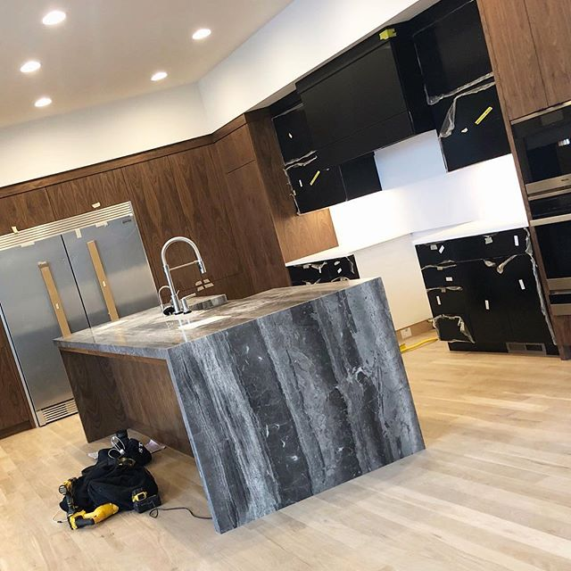 On-site today | Ready to take off the plastic & see these matte black cabinets! 🖤✨ . . @kohler @deltafaucet @mieleusa @frigidaire @eurowoodcabinets @gmswerks #walnut #oak #kitchencabinets #quartz #quartzite #modernkitchen #moderndesign #newconstruction #jobsite #omaha #interiordesign #aiomaha