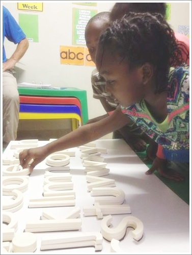 Students identify sounds to build words. Photo courtesy of Mary Jo Jean-Francois.