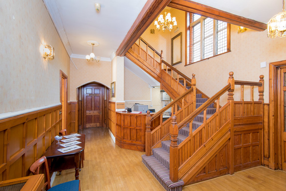 Wooden staircase in large home