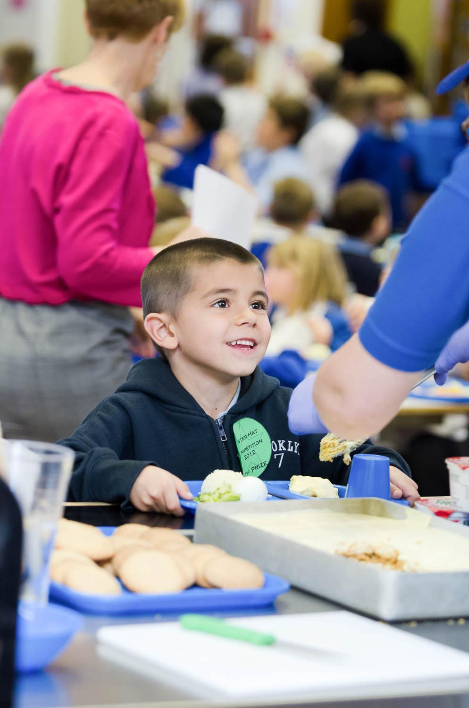 School boy being served lunch