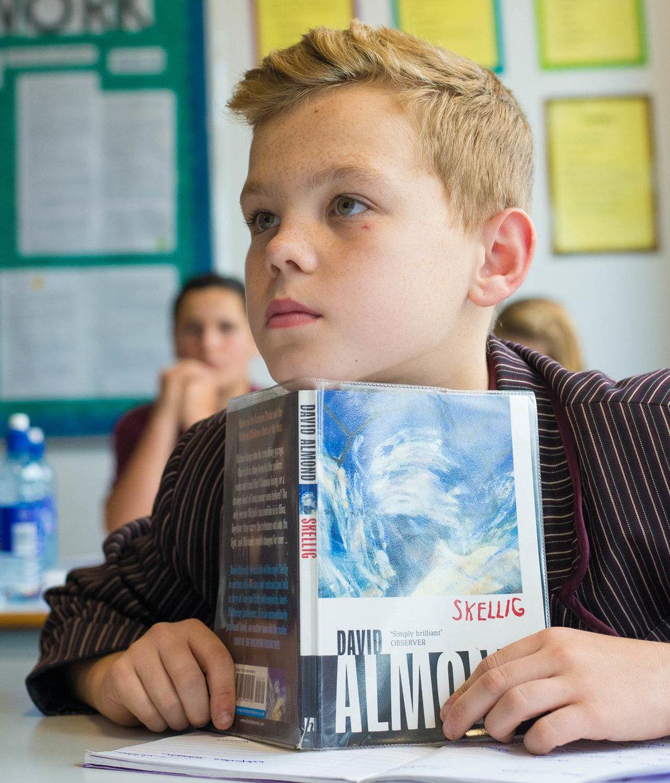 School boy with book