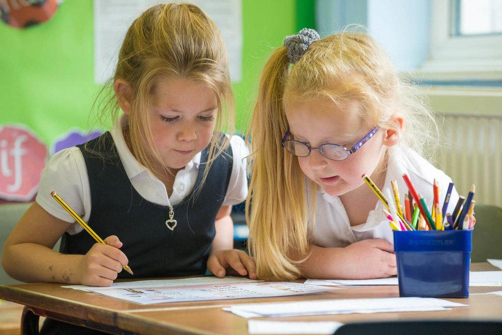 School girls at desk