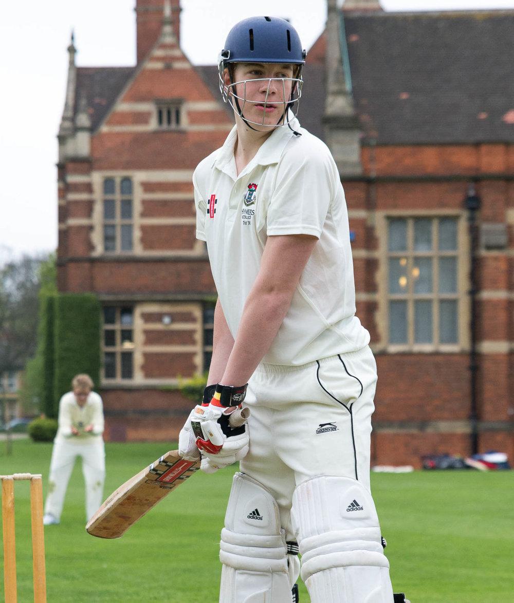 School cricket player at crease