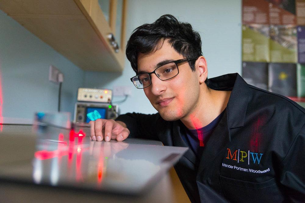 Student studies laser beams