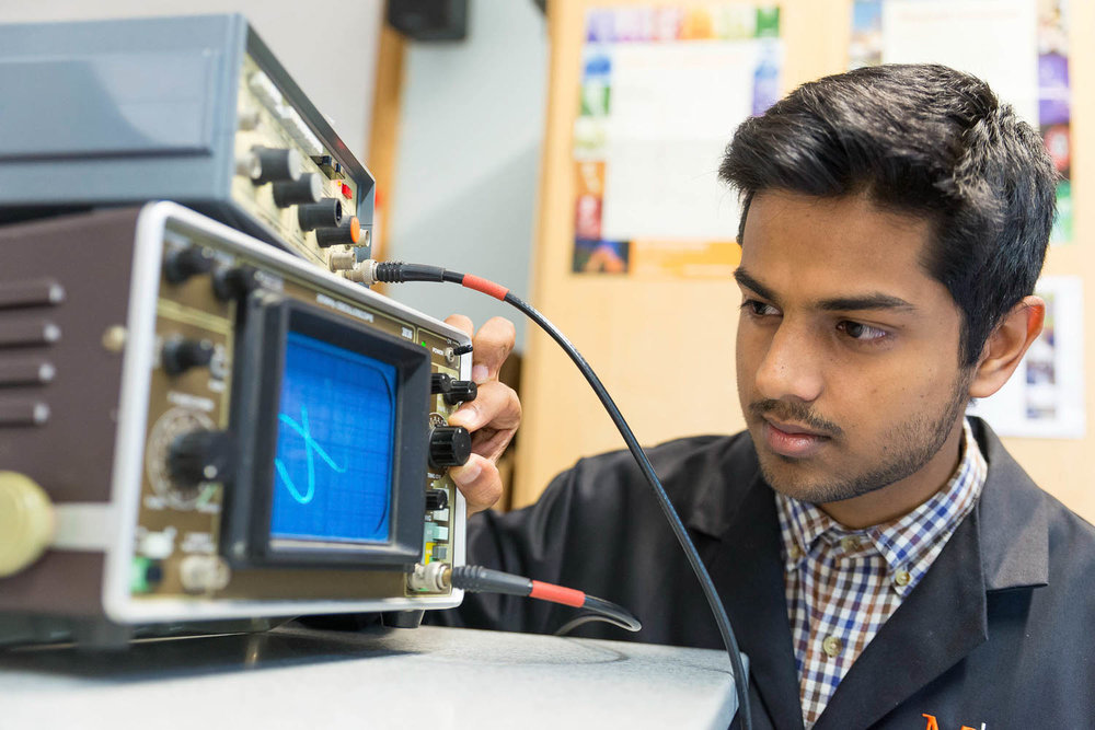 Student with wave form monitor