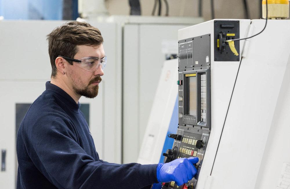 Man at work looking at machinery