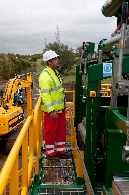 Worker checks large pumping machinery