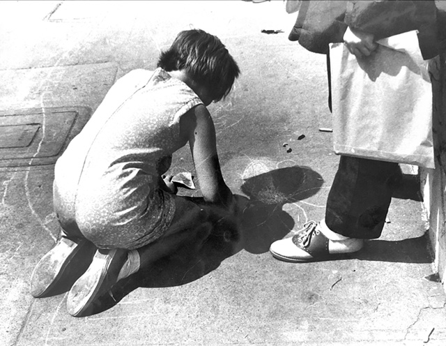 NB Festival History - Woman Drawing with Chalk.JPG