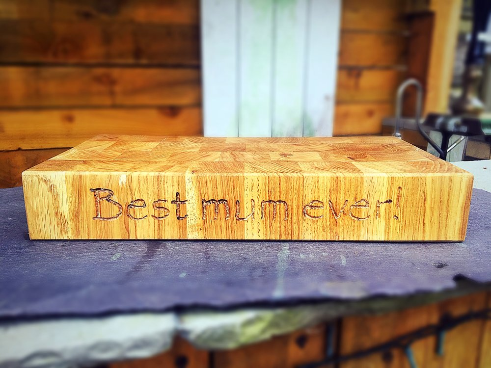 This beautiful board was created for a mum who's children wanted to get her a wood gift for Mother's Day to last a lifetime, in the form of a solid beech end grain butchers block with personalised engraving. Custom made to fit specifically in a special place on the kitchen worktop for her favourite teapot and accessories.
