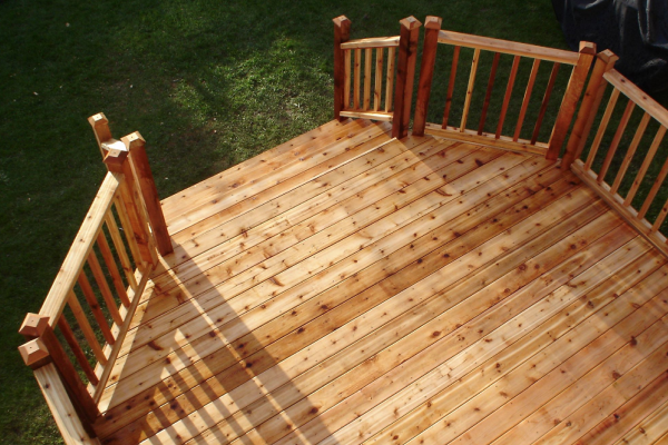 cedar decking - Sometimes, nothing beats the real thing. If you prefer the look of natural wood, we use premium cedar to build our wood decks and rails.