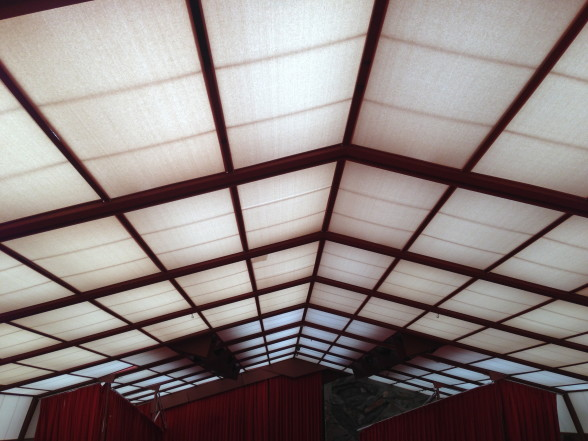 A layered canvas roof covers the performance hall.