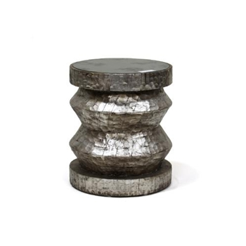 Sidetable that can double as a stool has a rustic glam style.