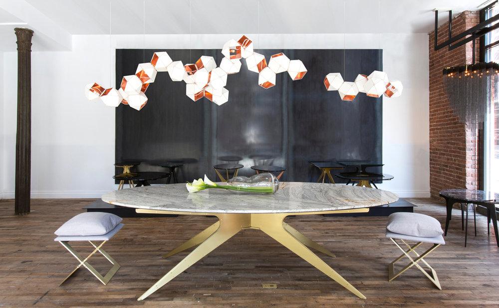 DEAN-Oval-Dining-Table---Brass-Gray---in-Showroom-web.jpg