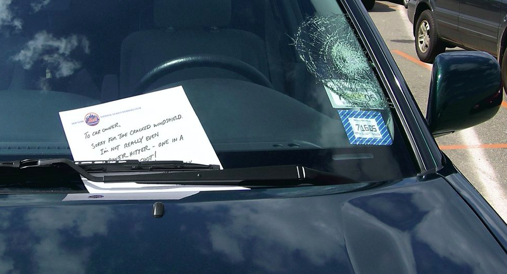 Broken window decals were placed on cars throughout NYC, along with a note from a Mets slugger apologizing for hitting the ball so far and smashing the window.
