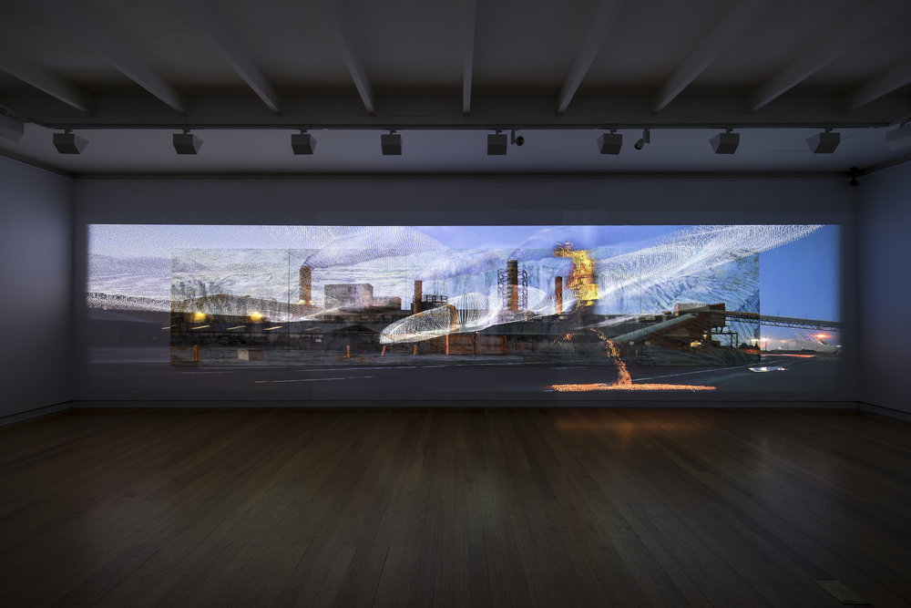 Alexander Boynes, Mandy Martin and Tristen Parr    Luminous Relic   2017, pigment, sand, crusher dust, acrylic and oil on linen; three-channel high-definition video with stereo sound score; 260cm x 1150cm (installation photo) A Geelong Gallery exhibition - 8 April to 9 July 2017 Courtesy of the artists and Australian Galleries, Melbourne and Sydney, Beaver Galleries, Canberra